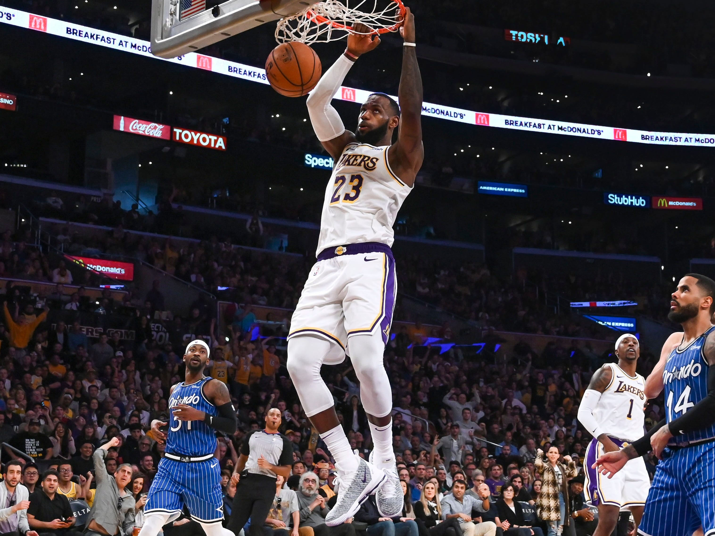 Nov. 25: Lakers forward LeBron James drives and finishes with the two-handed slam against the Magic.