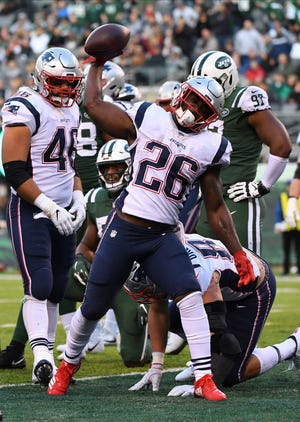 Patriots running back Sony Michel celebrates a fourth-quarter touchdown against the Jets, his fifth of the season.