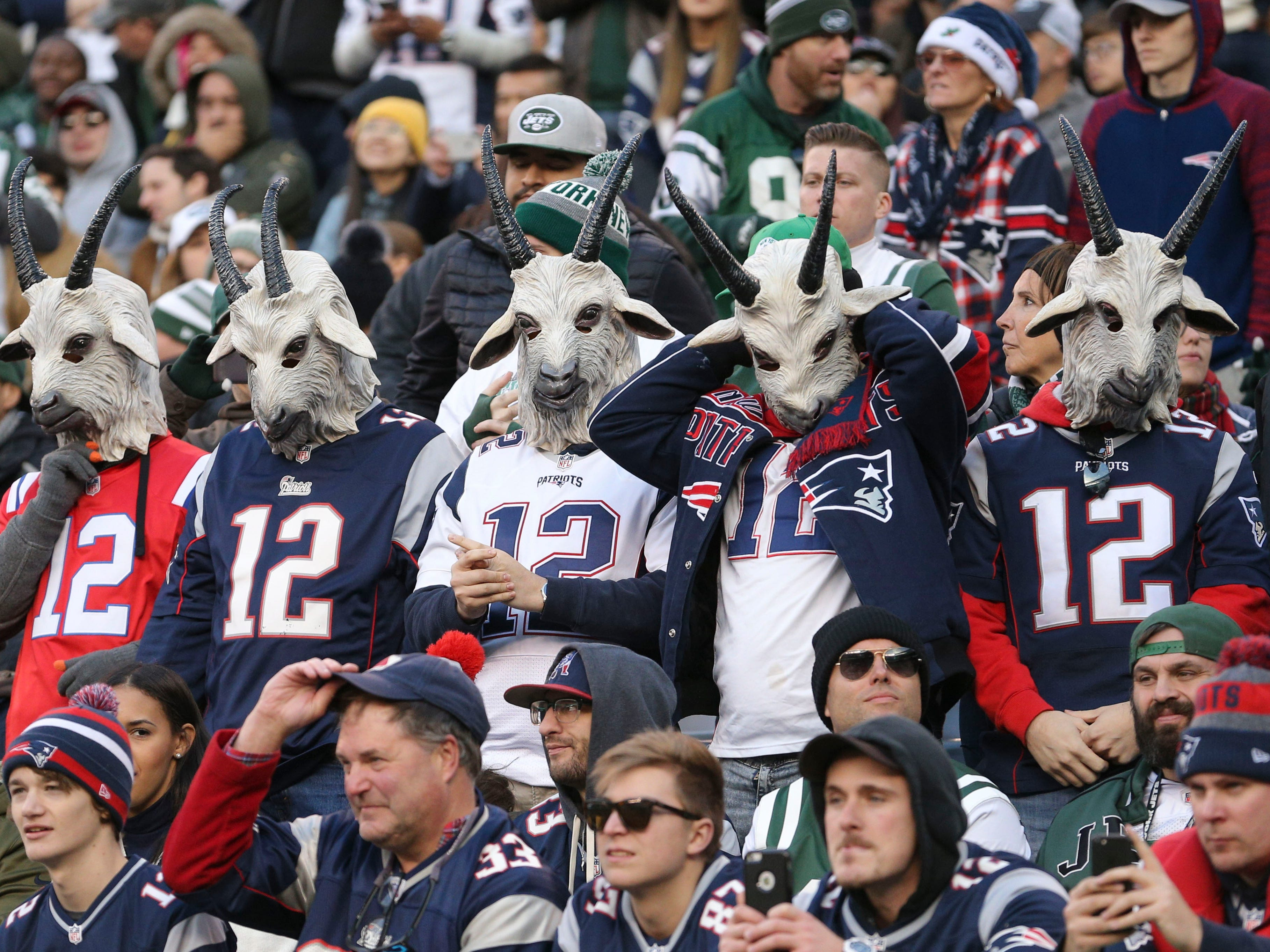 Fans wearing New England Patriots quarterback Tom Brady jerseys and goat masks stand during the fourth quarter against the New York Jets at MetLife Stadium.