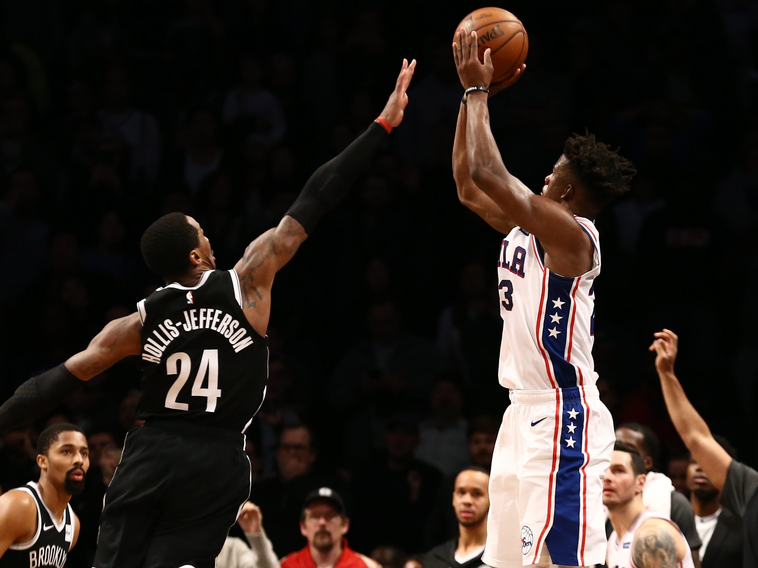 Nov. 25: Sixers forward Jimmy Butler (23) rises up a fires the game-winning 3-pointer over Nets defender Rondae Hollis-Jefferson (24) during the closing seconds in Brooklyn.