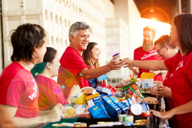 Wells Fargo team members give what they can through the company's Holiday Food Bank.