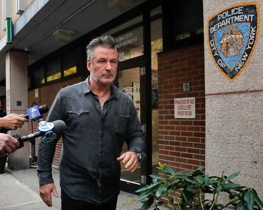 Actor Alec Baldwin walks out of the New York Police Department's 10th Precinct on Nov. 2, 2018, after he was arrested for allegedly punching a man in the face during a dispute over a parking spot outside his New York City home, authorities said.