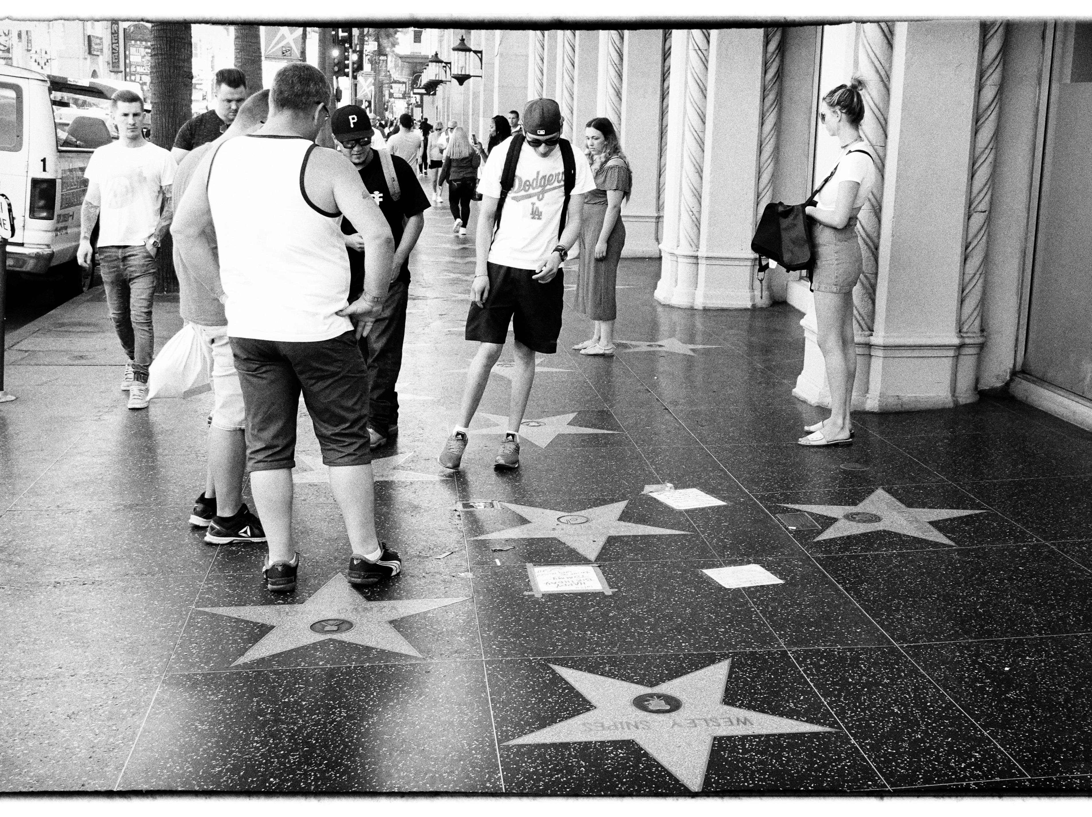 Checking out the stars on the Hollywood Walk of Fame