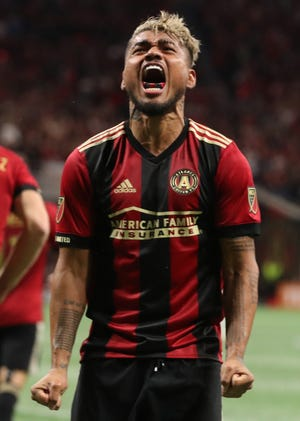 Atlanta United forward Josef Martinez celebrates after scoring against the New York Red Bulls during the first half of the first leg of the MLS Eastern Conference Championship at Mercedes-Benz Stadium.