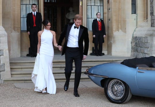 Prince Harry Duchess Meghan of of Sussex leave Windsor Castle on May 19, 2018 after their wedding to attend an evening reception at Frogmore House.