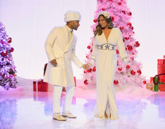 "John Legend, left, and Chrissy Teigen bring holiday music and magic to NBC in ""A Legendary Christmas with John and Chrissy."""