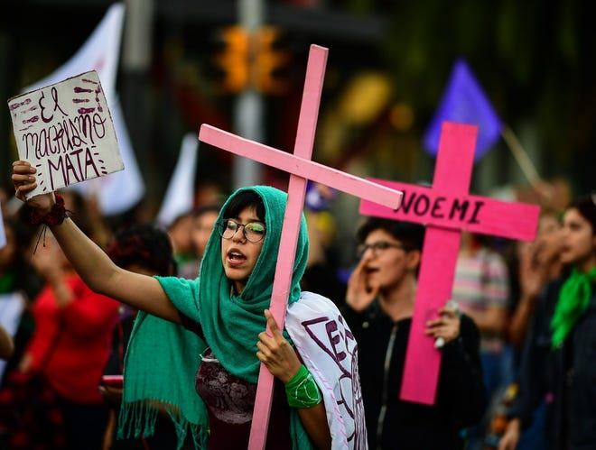 Women march during the commemoration of the International Day for the Elimination of Violence Against Women, in Mexico City on November 25, 2018.