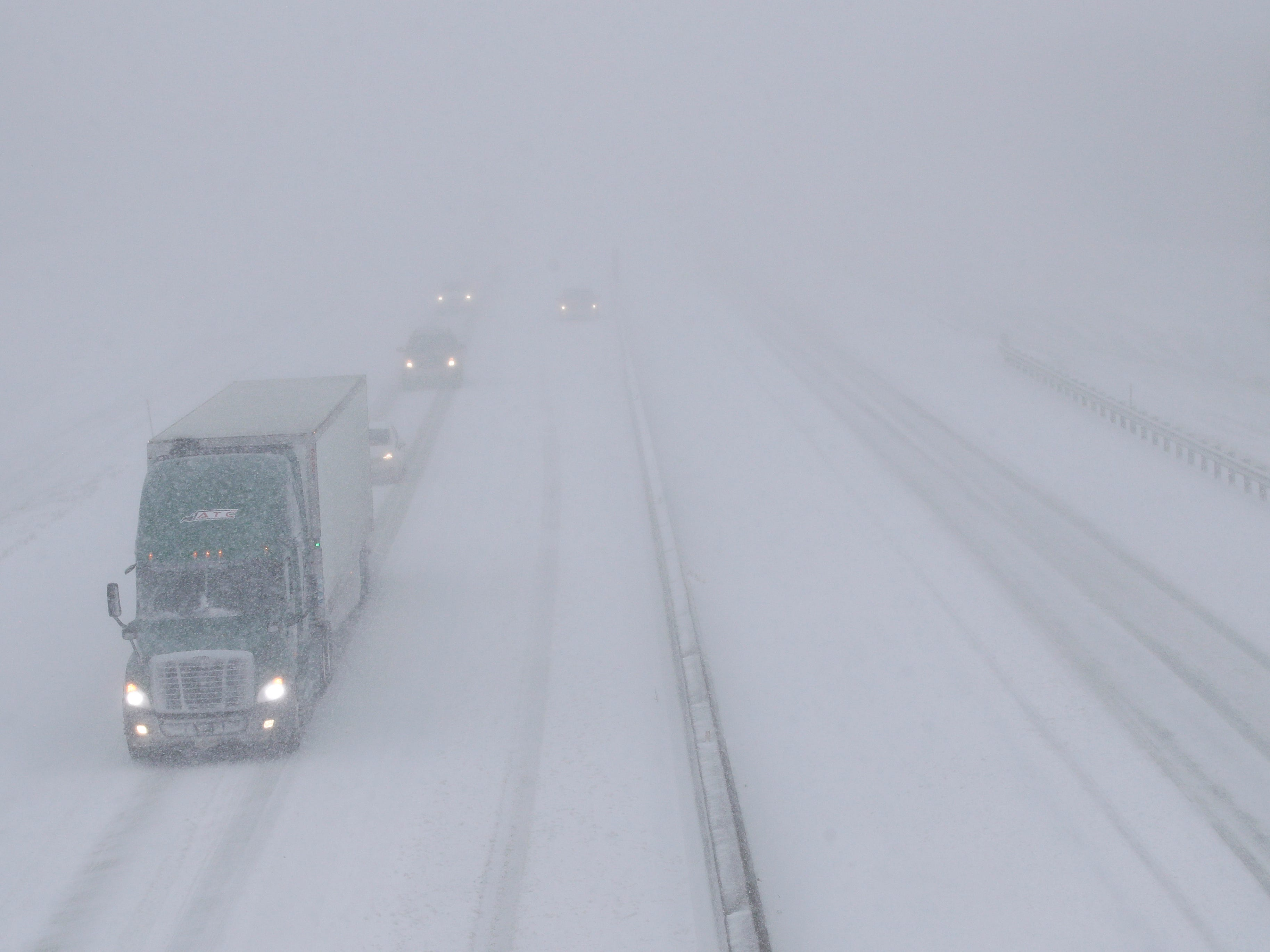 Traffic moves west along I-70 near Lawrence, Kan. on Nov. 25, 2018. The interstate is closed west of Junction City, Kan. because of the weather.
