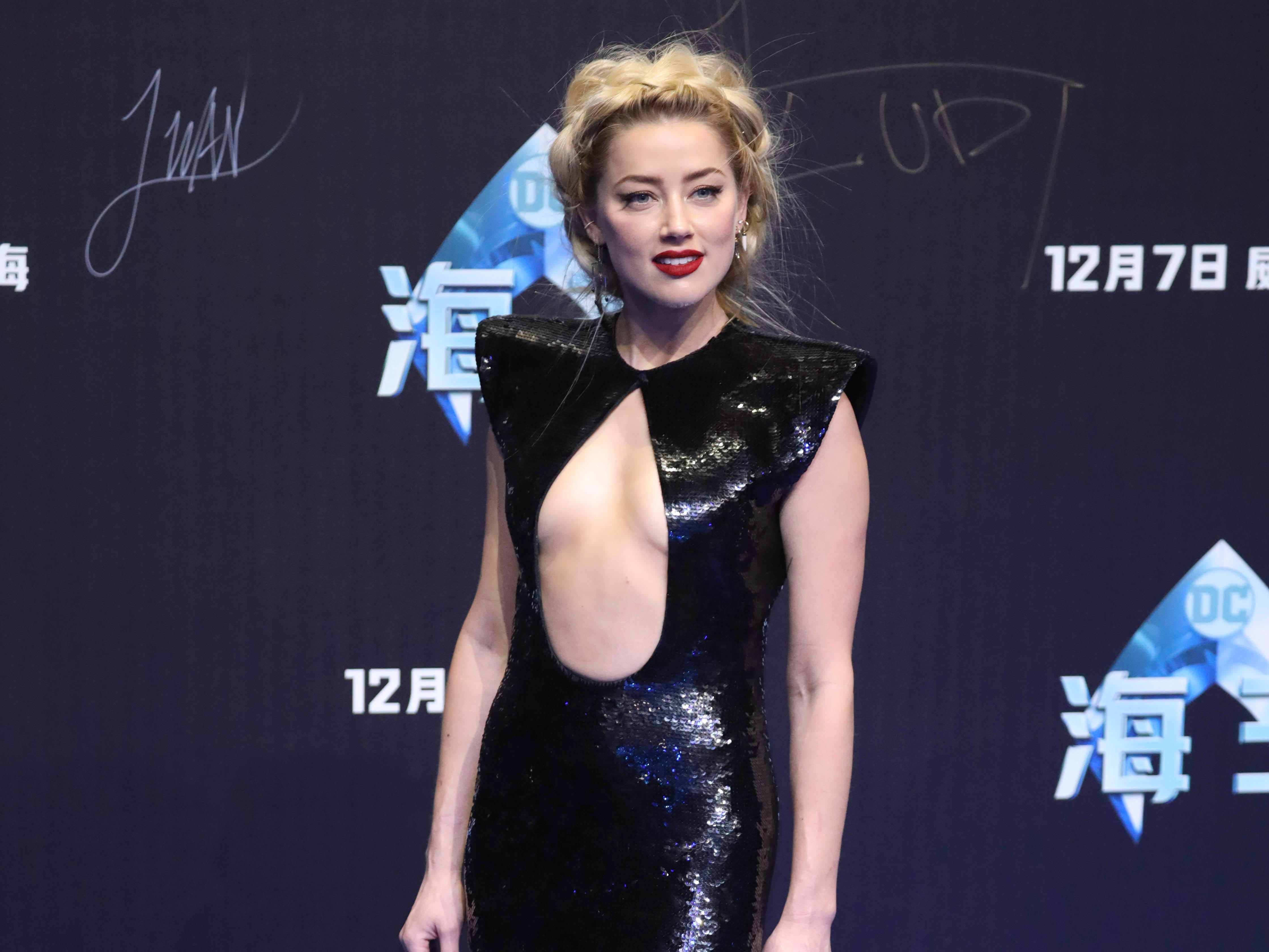 Actress Amber Heard poses for a photo during an event in Beijing, China, Sunday, Nov. 18, 2018, ahead of the Aquaman movie's December world premiere. (AP Photo/Ng Han Guan) ORG XMIT: XHG106