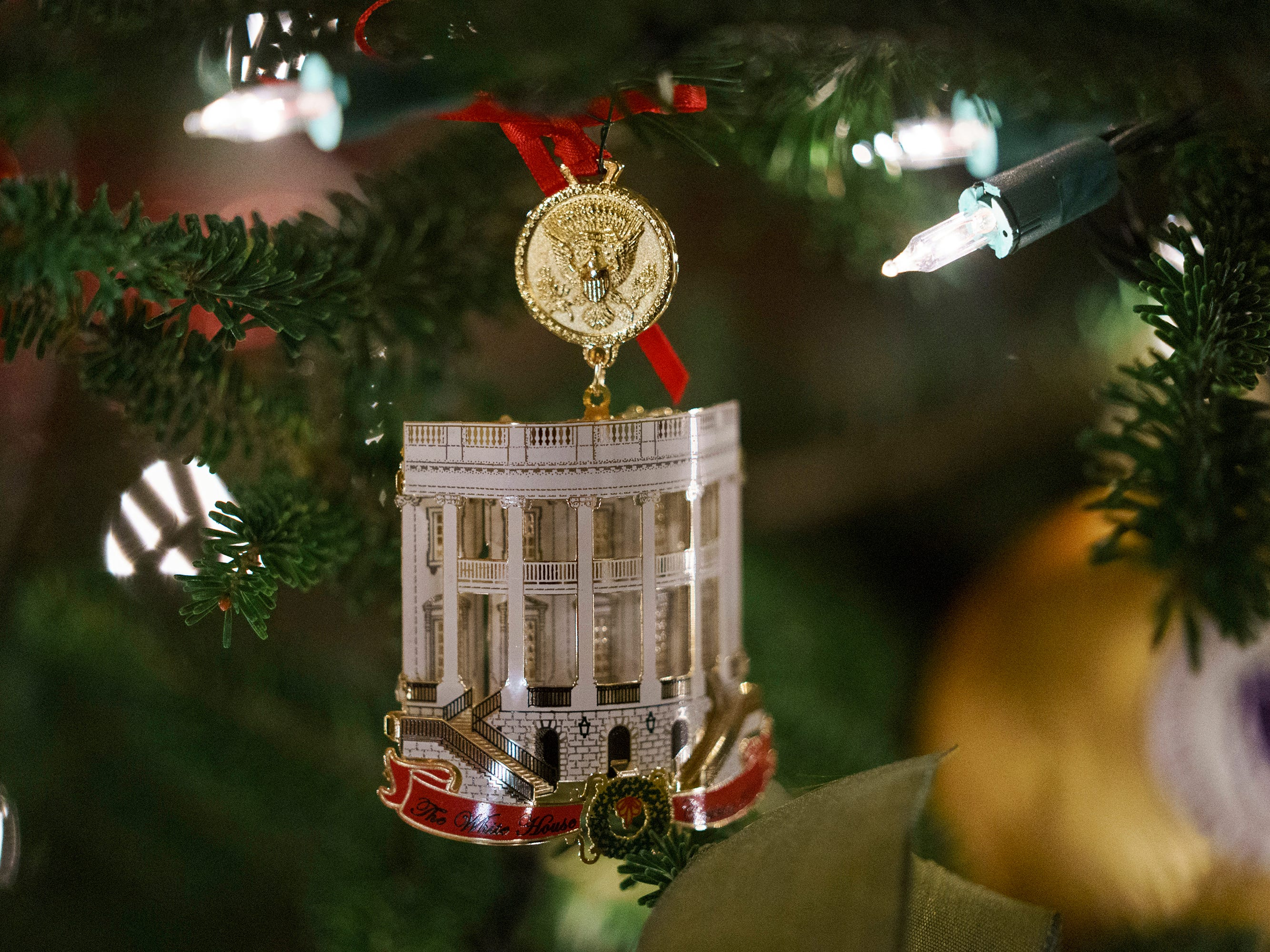The Official 2018 White House Christmas Ornament is seen during the 2018 Christmas Press Preview at the White House in Washington, Monday, Nov. 26, 2018.