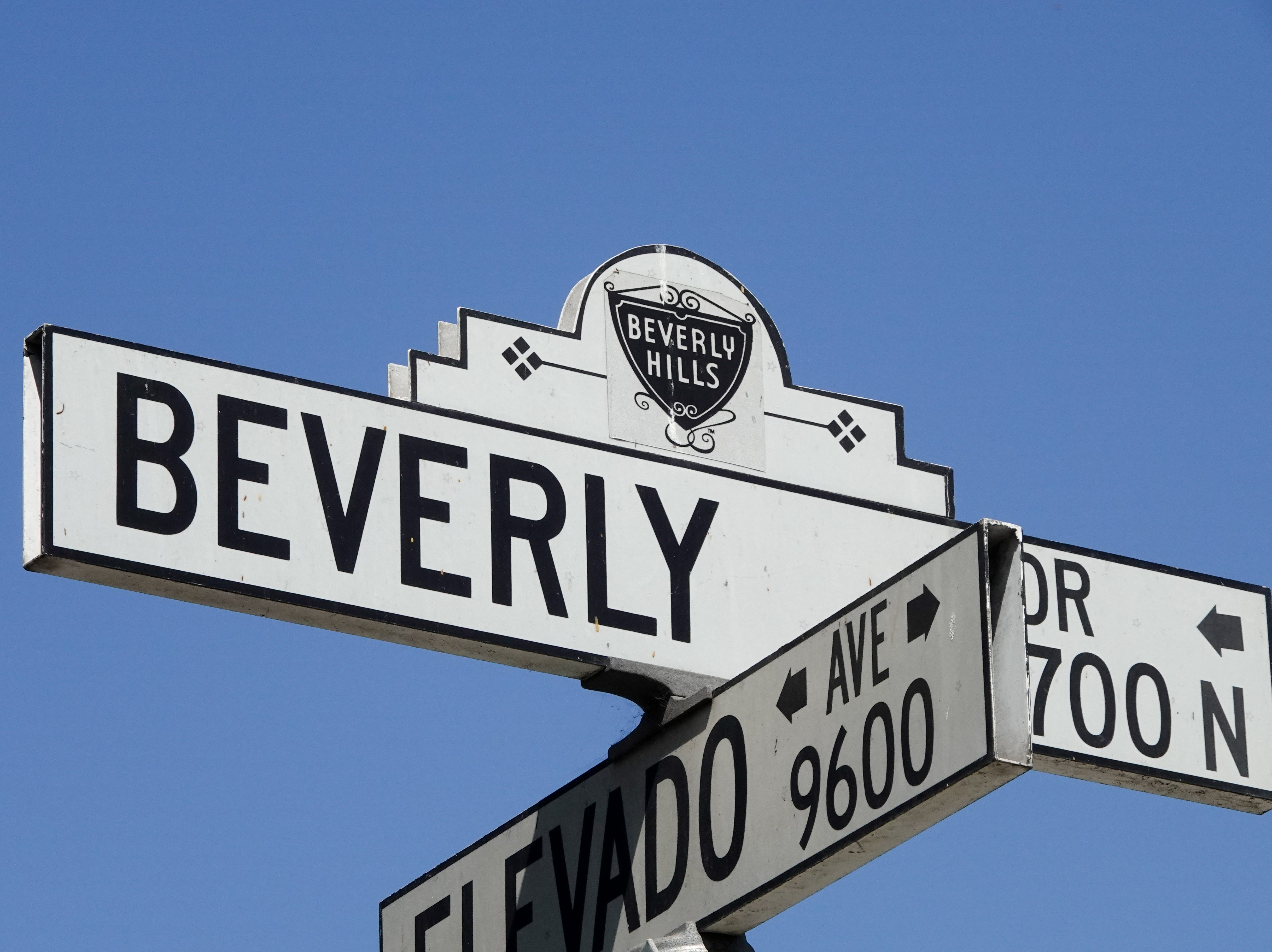 Next stop: Beverly Hills. The corner of N. Beverly Drive and Elevado in Beverly Hills is just down the street from the fabled Beverly Hills Hotel, and is a popular tourist spot for seeing giant mansions and oversize palm trees.