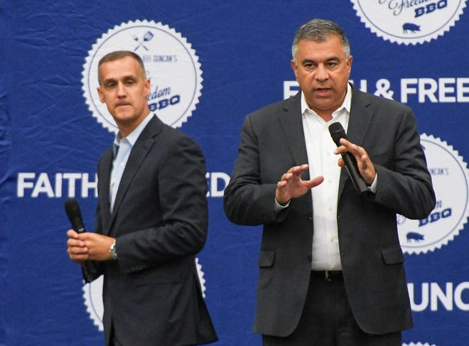 Corey Lewandowski, left, and David Bossie take turns speaking during the Faith and Freedom barbecue fundraiser in August.