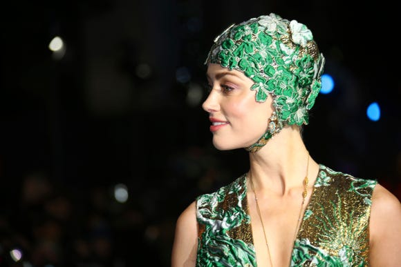 Actress Amber Heard looks like a member of the Aqualillies water ballet in her fancy swim cap.