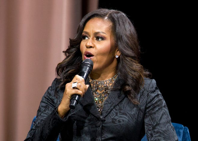 "Former first lady Michelle Obama speaks to the audience during a stop on her book tour for ""Becoming,"" in Washington on Nov. 25, 2018."
