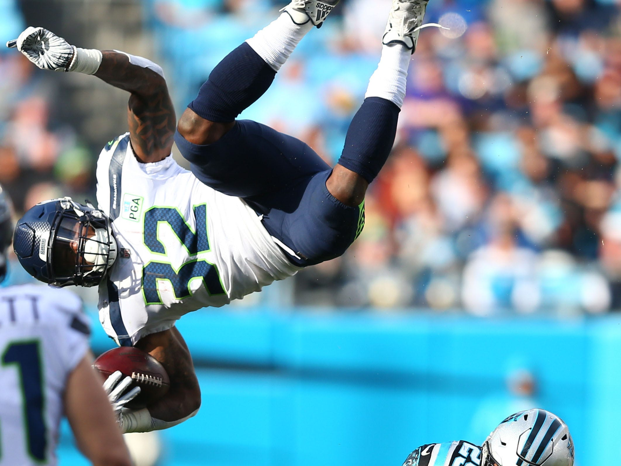 Carolina Panthers strong safety Eric Reid knocks Seattle Seahawks running back Chris Carson in the air during a Week 12 game at Bank of America Stadium.