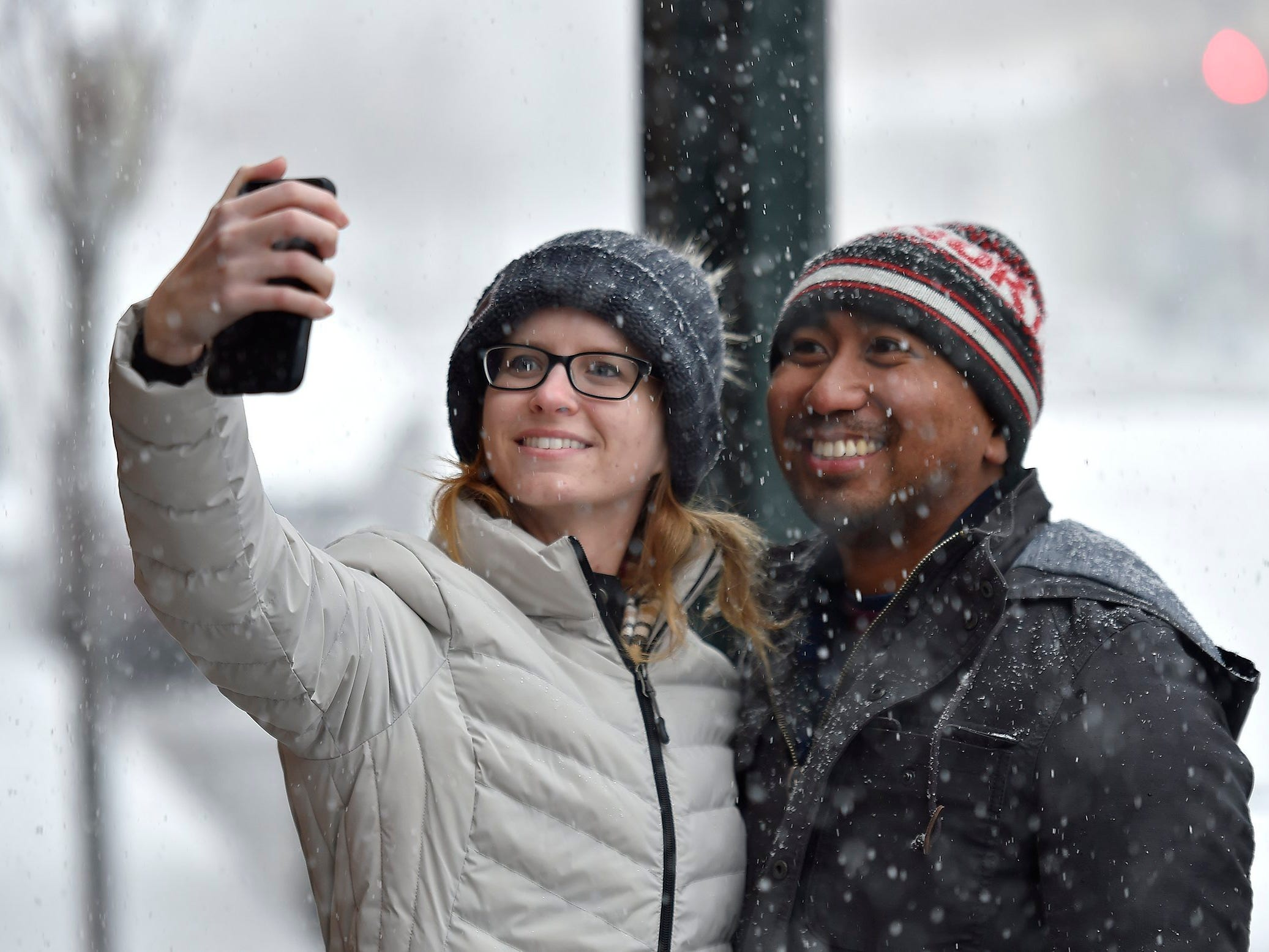 It was only the third time Kristin Brooker has seen snow, so a selfie was in order on Nov. 25, 2018, with friend Dominic Francia, who grew up in Kansas City. The pair stopped on their walk around the Country Club Plaza just as the heavy snow began to fall. Both now live in Los Angeles.