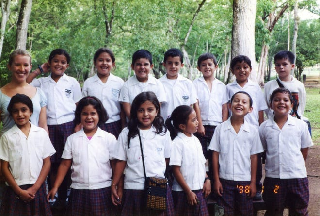 Meghan Steed, left, with her students in Copan Ruinas, Honduras. June, 2003.
