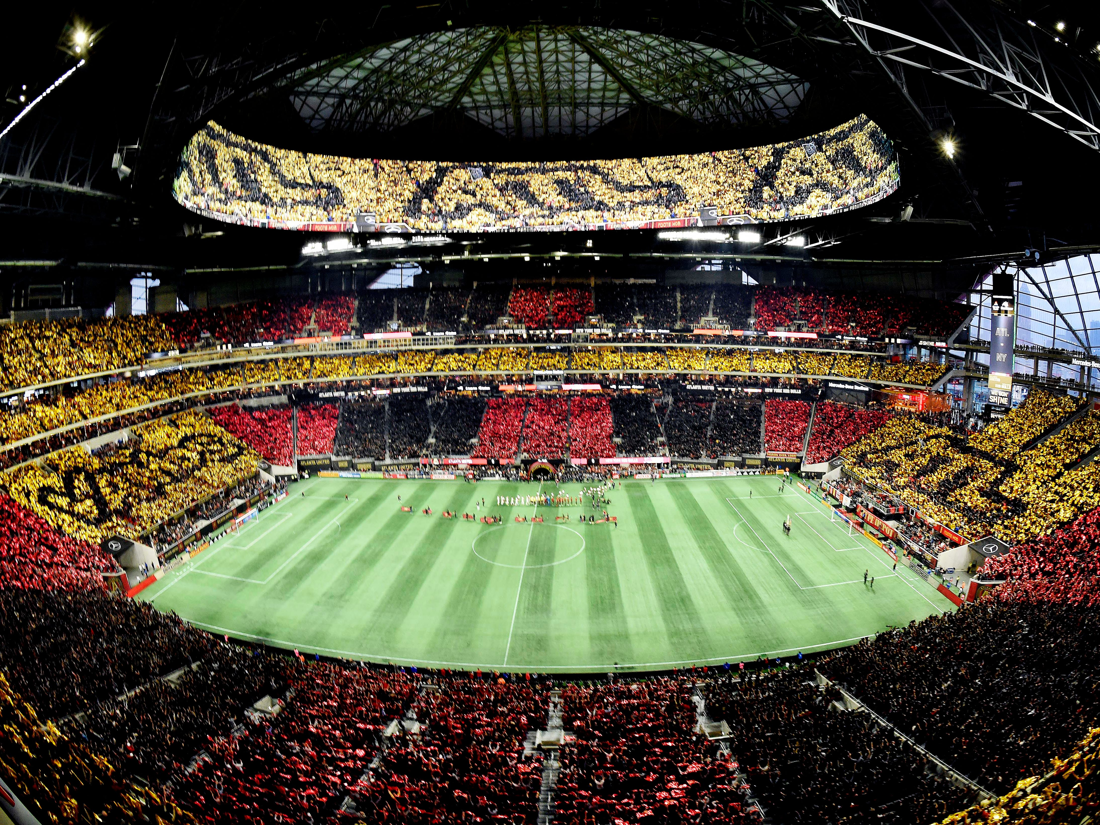 Atlanta United fans perform a tifo stunt prior to the first leg of the MLS Eastern Conference Championship against the New York Red Bulls at Mercedes-Benz Stadium.