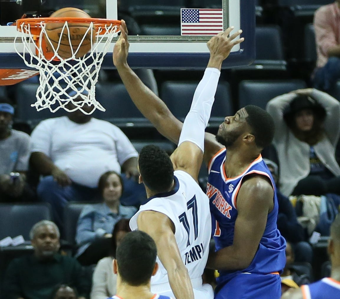 Nov. 25: Knicks guard Emmanuel Mudiay (1) throws down the ferocious one-handed slam over Grizzlies defender Garrett Temple (17).