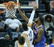 Nov. 25: Knicks guard Emmanuel Mudiay (1) throws down the ferocious one-handed slam over Grizzlies defender Garrett Temple (17).