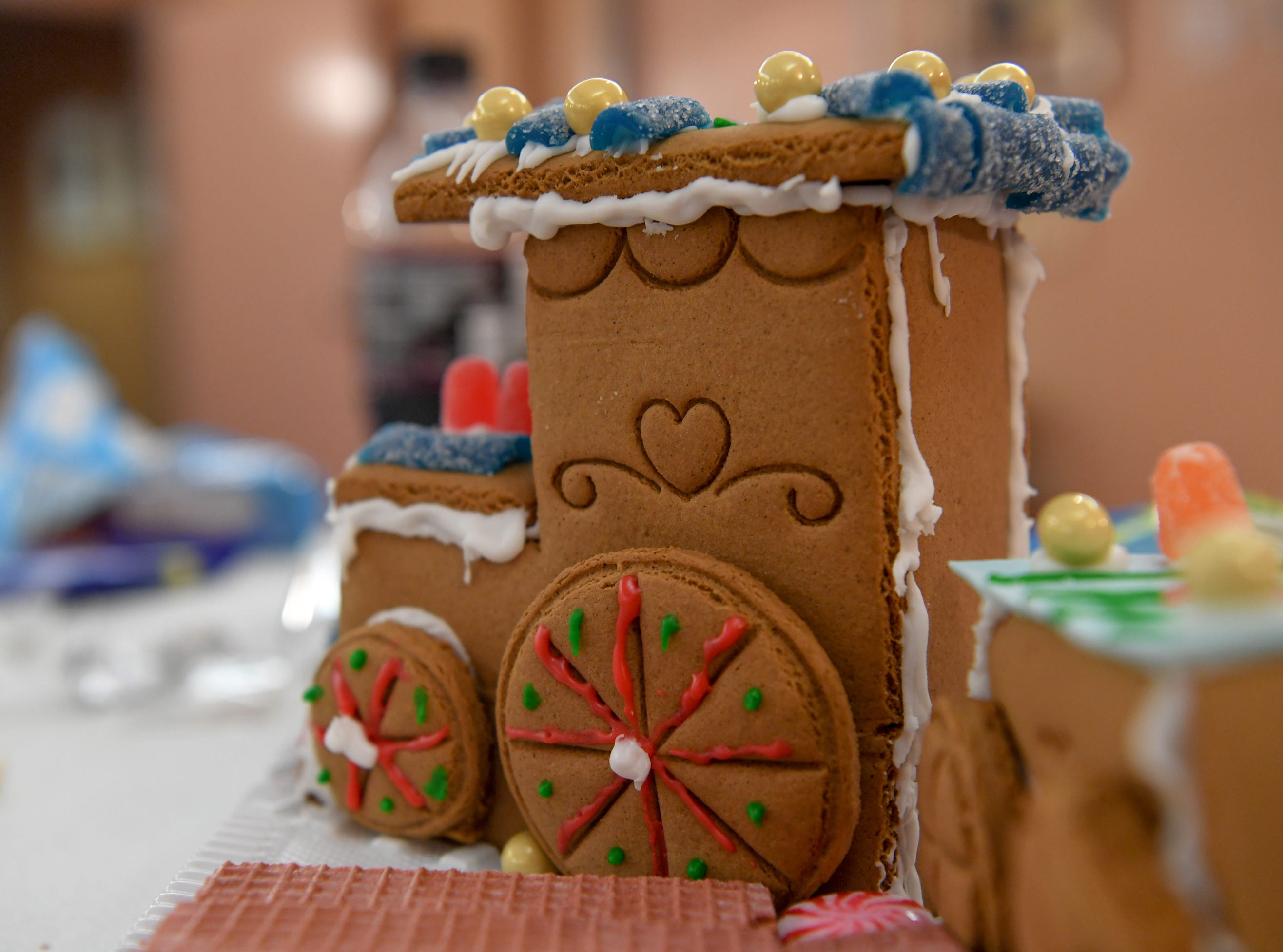 Details of gummy candies and icing decorate a train-shaped gingerbread creation during the Big Brothers Big Sisters of the Upstate gingerbread house decorating party at the Anderson County Museum in Anderson on Tuesday.