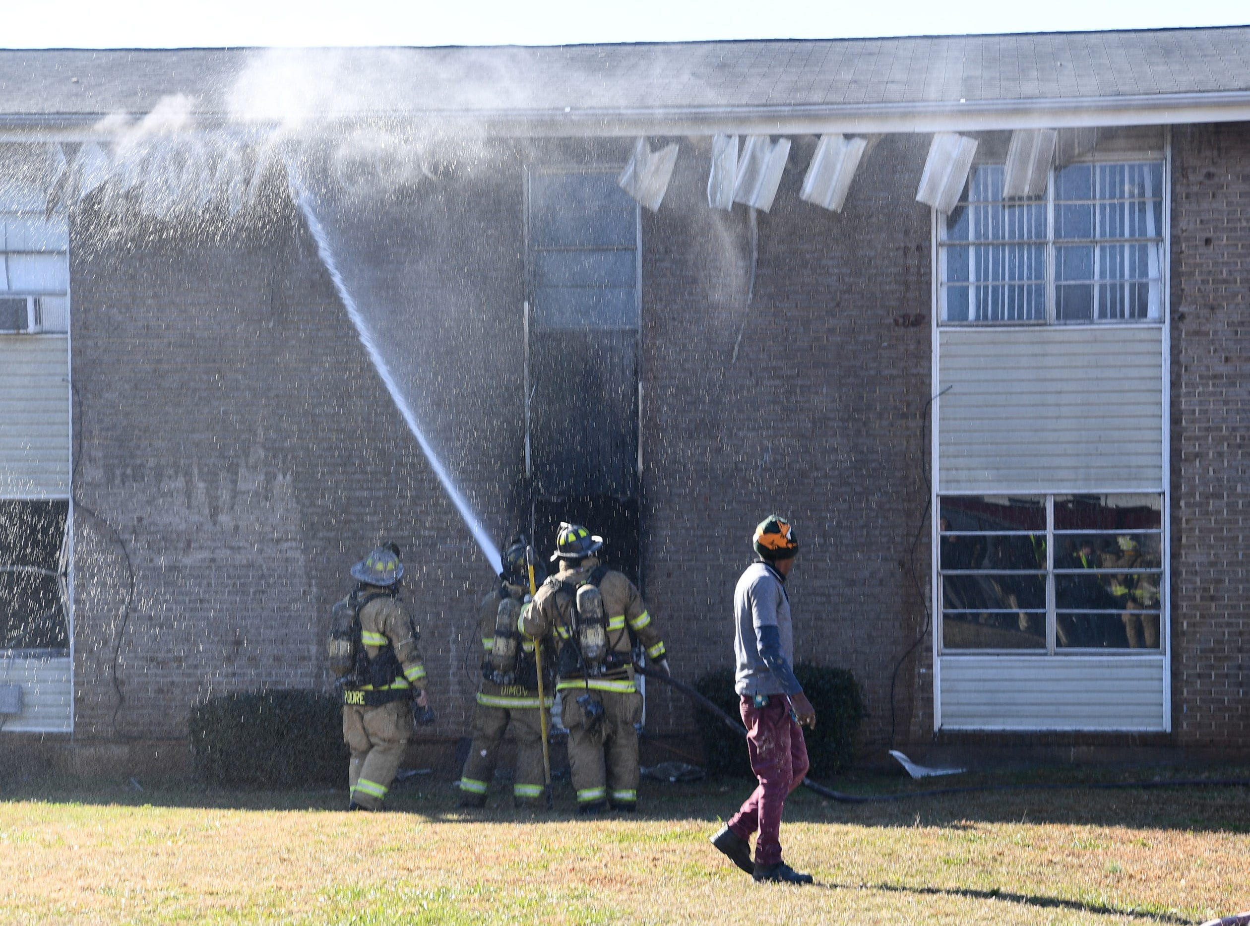 Anderson fire respond to a fire in building 8 of the Friendship Court Apartments in Anderson on Tuesday.