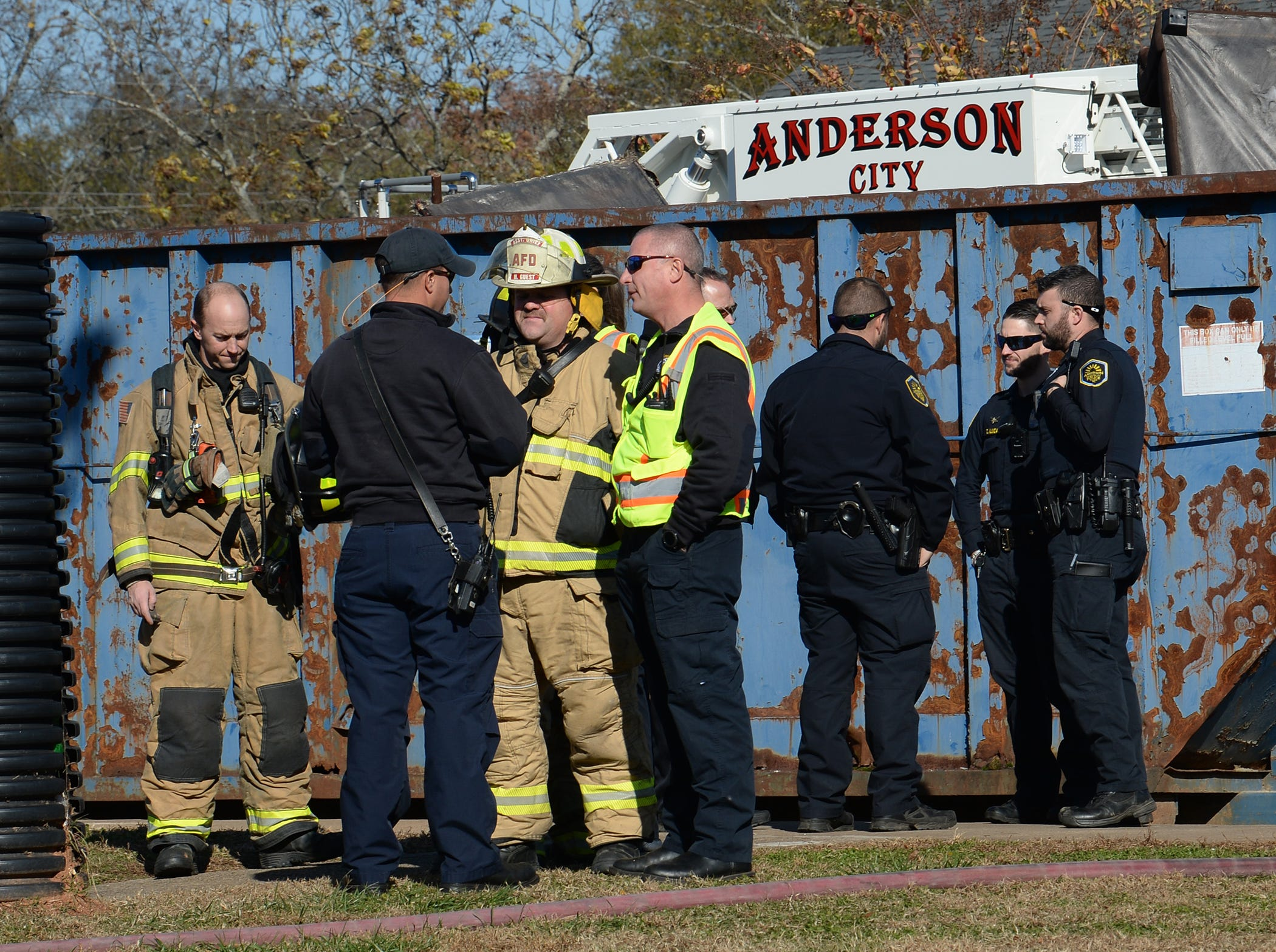 Anderson fire and city police respond to a fire in building 8 of the Friendship Court Apartments in Anderson on Tuesday.