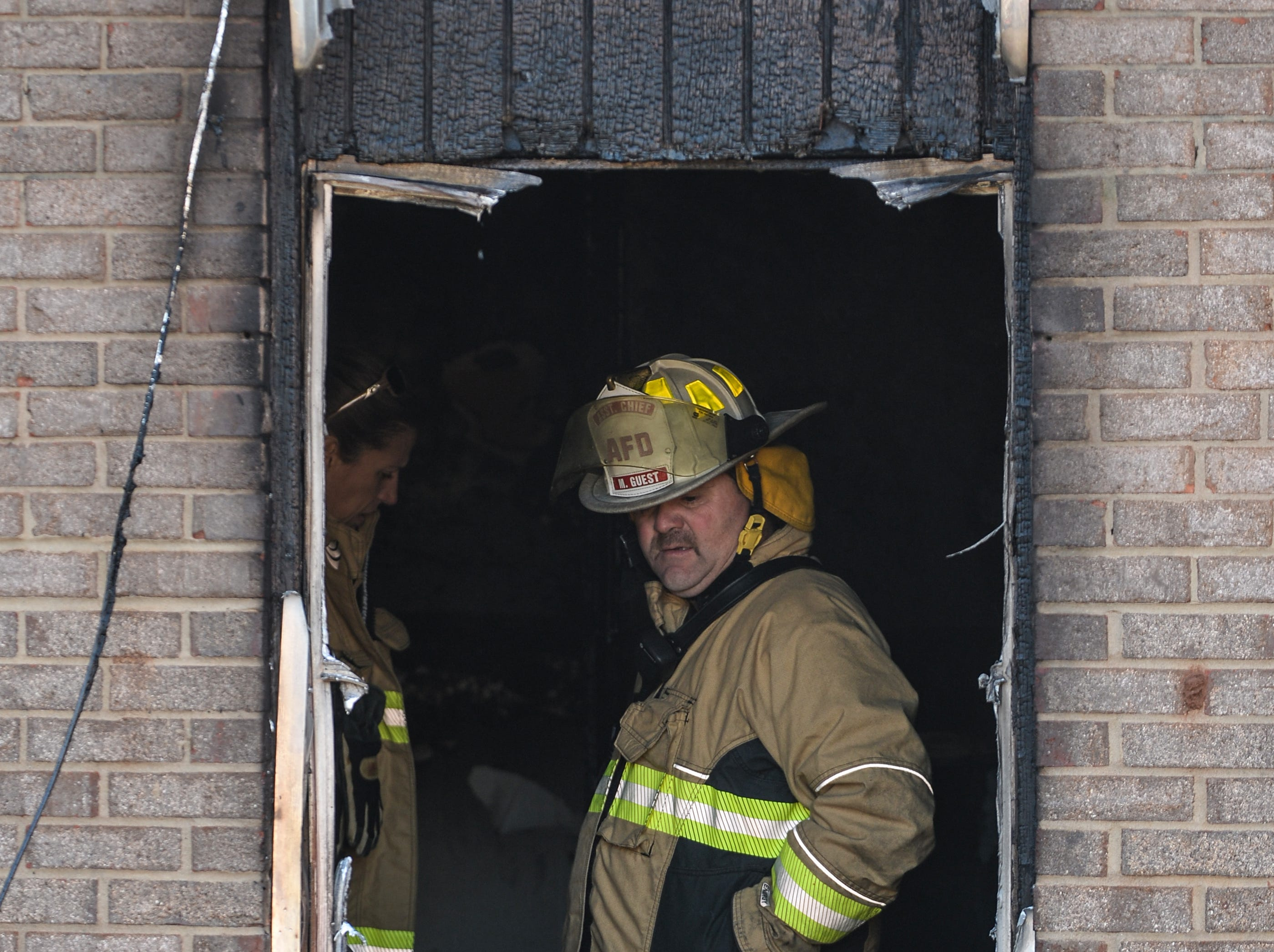 Anderson Assistant Chief Michael Guest looks over damaged apartment in building 8 of the Friendship Court Apartments in Anderson on Tuesday.