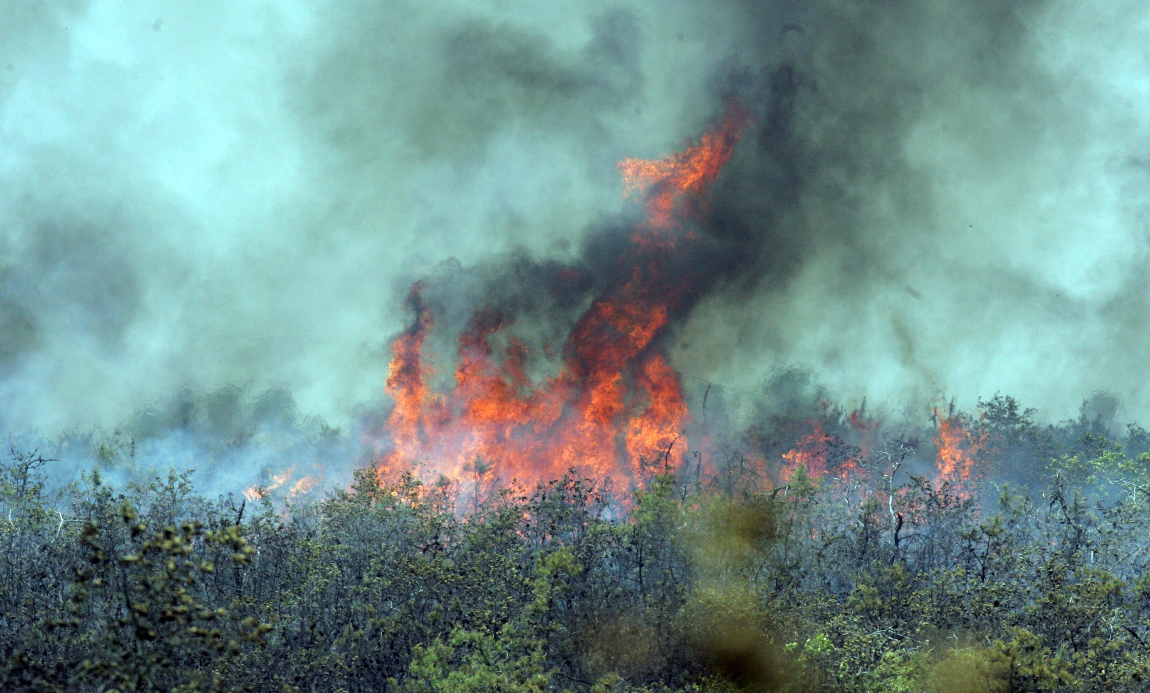 Tim McCarthy/staff photographer 051607 - POCEAN - Fire burning at mid-day on the Warren Grove Range in 2007.