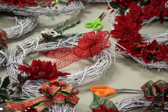 A work table became filled with finished wreaths recently at Pioneer Drive Baptist Church.