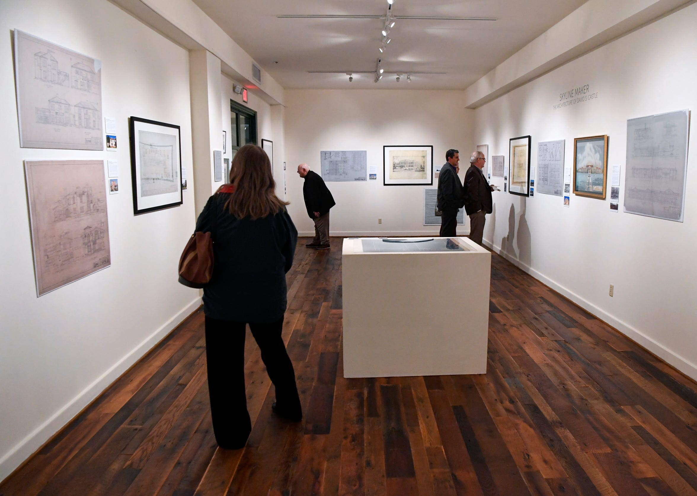 """Visitors to the Grace Museum Thursday Nov. 8, 2018 peruse the new exhibit, """"Skyline Maker: The Architecture of David S. Castle."""" Castle was a local architect who designed the Federal Building, Lincoln Middle School, Abilene High School, and other public buildings in the Key City."""