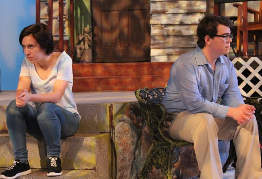 """Catherine (Ashleigh Moss, left) and Hal ( Kevin Roberts) express their disconnect in their seating postures in this rehearsal scene from """"Proof,"""" McMurry University's drama that opens a two-weekend run Thursday."""