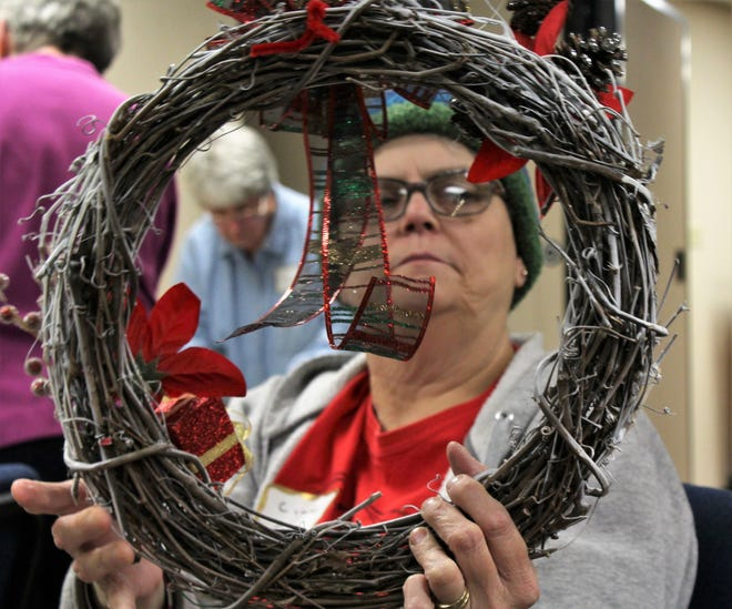 Cindy Crane looks over her wreath during a recent workshop at Pioneer Drive Baptist Church.