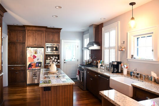 """The back wall of Linda and Marc Voorhees' Montford home was collapsing when they bought the house but they were able to remodel creating a """"family-style"""" kitchen from the original three rooms. """"We're not really formal people sit this met our needs"""" Linda said."""