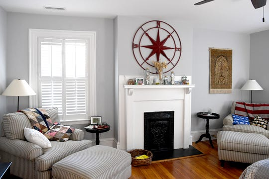 Linda and Marc Voorhees displays the best of their lives spent traveling. A prayer rug from Turkey hangs on the wall of their bedroom above his and hers reading chairs.