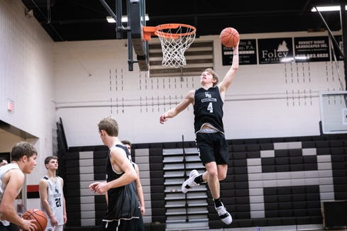 North Buncombe's Ren Dyer dunks during practice Nov. 26, 2018.