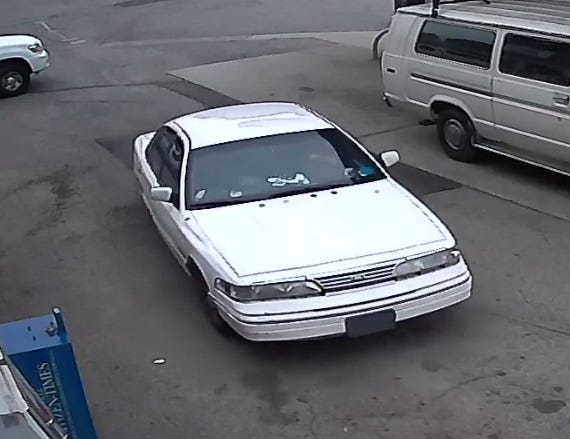 Asheville police are seeking information on a white Ford Crown Victoria similar to this one.