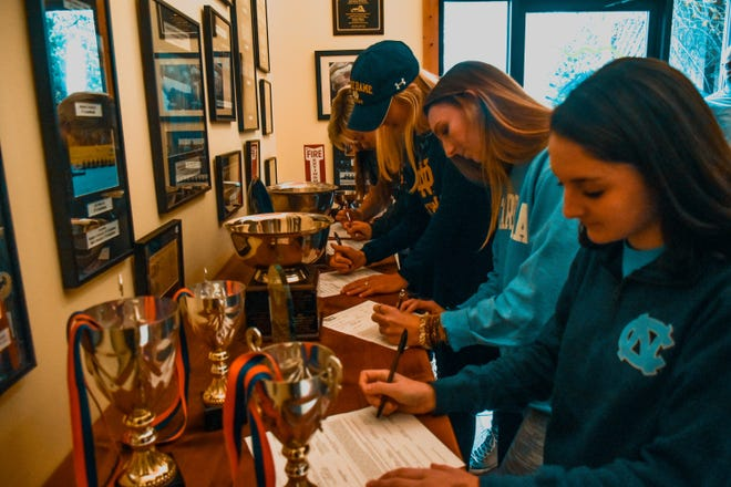 Five local seniors from the Asheville Youth Rowing Assocationsigned Division I scholarships Monday to continue rowing at the next level.