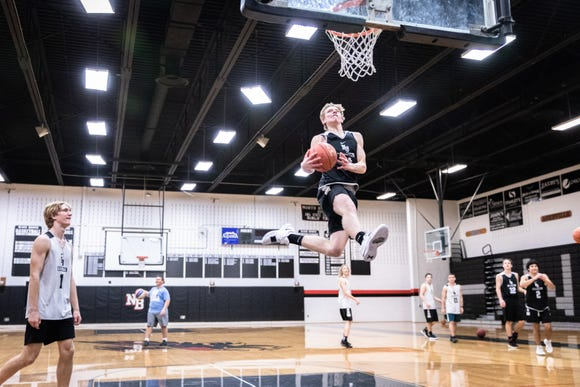 North Buncombe's Ren Dyer attempts to dunk during practice Nov. 26, 2018.