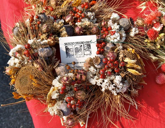 This wreath from Gaining Ground Farm is typical of the handmade items available at holiday markets around Western NC.