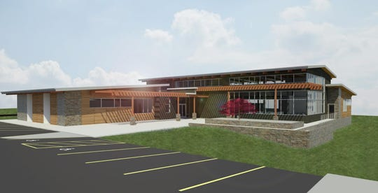 Renderings show the exteriors of a $5.8 million project to build a new East Asheville library.