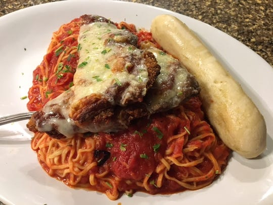 Featuring Italian gourmet cuisine, one of the signature dishes at the Lucky Rooster Kitchen & Cocktails is the Pork Parmesan.