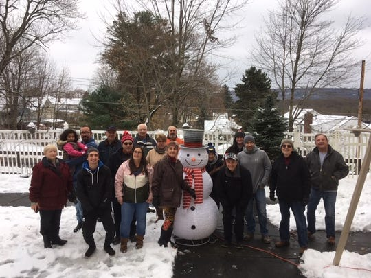 Members of the Endicott Rotary Club decorated the outside of Ideal Senior Living Center in Endicott.