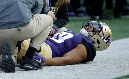 Washington tight end Hunter Bryant after being injured during an Oct. 28, 2017, game against UCLA.