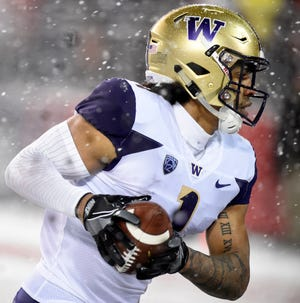 Huskies tight end Hunter Bryant caught a touchdown during Friday's Apple Cup win over Washington State.