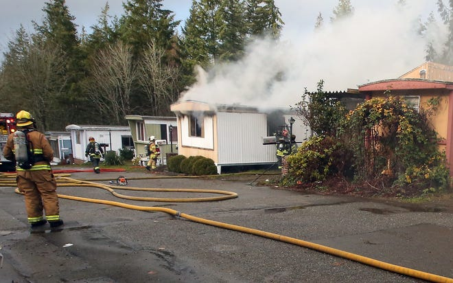 Firefighters from Central Kitsap, Bremerton and Navy Northwest battled a 2-alarm structure fire at the Country Lane Mobile Home Park in Bremerton on Tuesday, November 27, 2018.