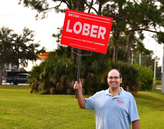 Bryan Lober campaigns at the Moose Lodge on Merritt Island on Election Day.