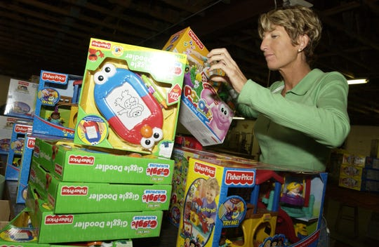 Shelley Johnson. shown in this file photo from a 2005 Reaching Out toy distribution, has long been a supporter of the holiday fund, which buys toys for children and gifts for seniors in Brevard County.