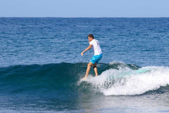 Austin Hollingshead, 20, of Melbourne Beach competes in the Rincon 50 Surf Festival in Puerto Rico.