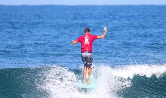 Hollingshead, 20, of Melbourne Beach competes in the Rincon 50 Surf Festival in Puerto Rico.